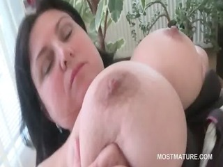 breasty older wench rubbing her bulky cunt