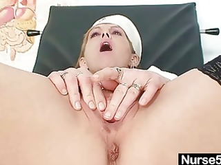 slender milf nora opens muff with speculum